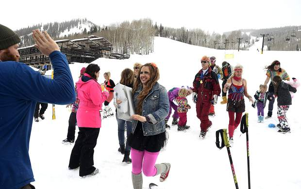 Jordan Testerman greets his wife Stacy after she took home first place in this years '80s costume contest Friday at Sunlight Mountain Resort. Testerman won a free season pass for next season.