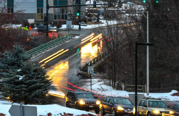 Early rush hour traffic makes its way over the 27th Street Bridge near Midland Avenue on a wet Thursday afternoon.