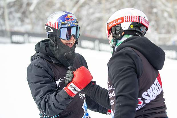 Scotty James, left, and Chris Klug shake hands after competing against each other in the Special Olympics Unified Snowboarding final at X Games in Aspen on Thursday.