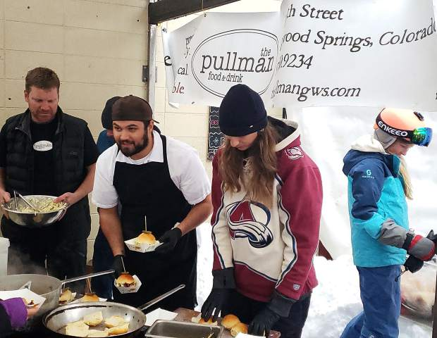 A crew from the Pullman restaurant serves up sliders at the Taste of Sunlight contest Saturday, which was part of the annual Ski Spree festivities Saturday and Sunday at Sunlight Mountain Resort south of Glenwood Springs. The weekend included ski races, a mountain treasure hunt, fireworks and fire dancers.