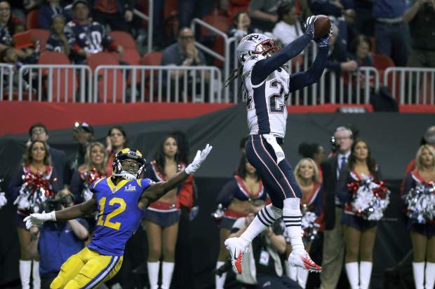 New England Patriots' Stephon Gilmore, right, intercepts a pass intended for Los Angeles Rams' Brandin Cooks (12) during the second half of the NFL Super Bowl 53 football game Sunday, Feb. 3, 2019, in Atlanta. (AP Photo/David J. Phillip)
