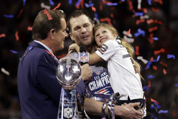 New England Patriots' Tom Brady holds his daughter, Vivian, after the NFL Super Bowl 53 football game against the Los Angeles Rams, Sunday, Feb. 3, 2019, in Atlanta. The Patriots won 13-3. (AP Photo/Mark Humphrey)