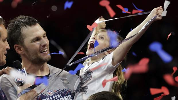 New England Patriots' Tom Brady holds his daughter, Vivian, after the NFL Super Bowl 53 football game against the Los Angeles Rams, Sunday, Feb. 3, 2019, in Atlanta. The Patriots won 13-3. (AP Photo/Lynne Sladky)
