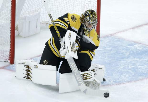Boston Bruins' Jaroslav Halak, of Slovakia, deflects an attempt on goal during the first period of an NHL hockey game against the Colorado Avalanche, Sunday, Feb. 10, 2019, in Boston. (AP Photo/Steven Senne)