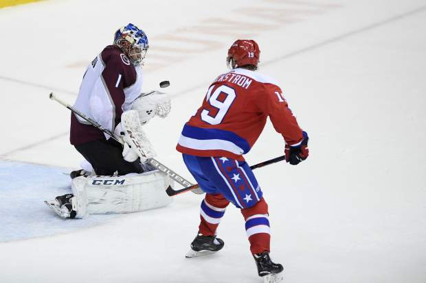 Colorado Avalanche goaltender Semyon Varlamov (1), of Russia, stops the puck from Washington Capitals center Nicklas Backstrom (19), of Sweden, during the third period of an NHL hockey game, Thursday, Feb. 7, 2019, in Washington. (AP Photo/Nick Wass)