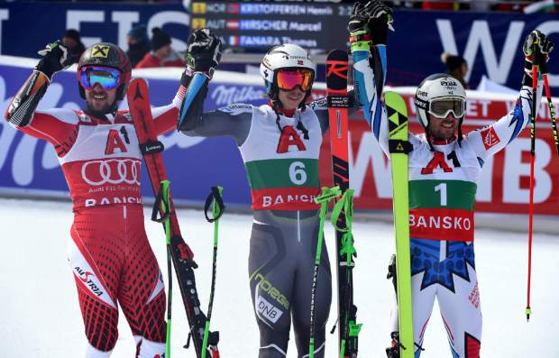 Norway's Henrik Kristoffersen, center, winner of a men's World Cup giant-slalom, poses with second placed Austria's Marcel Hirscher , left, and third placed France's Thomas Fanara, in Bansko, Bulgaria, Sunday, Feb. 24, 2019. (AP Photo/Marco Tacca)