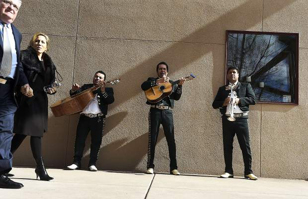 A mariachi band serenades people as they exit Jim Calaway's celebration of life in Carbondale Saturday.
