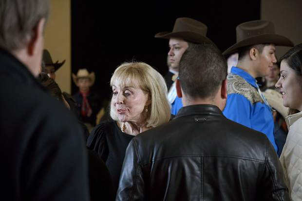 Connie Calaway greets people as they flow into the reception at the Third Street Center Saturday in Carbondale.