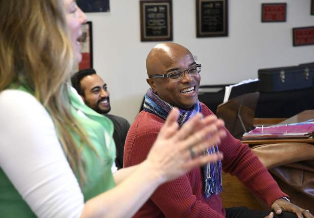 Shanti Gruber, Art Williams and Leon Williams share a laugh as they work with the concert choir Tuesday at Glenwood Springs High School.
