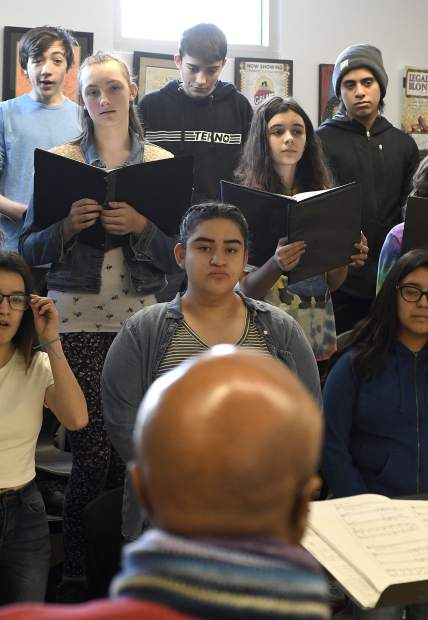Members of the Glenwood Springs High School concert choir listen to visiting singer Leon Williams during an outreach program Tuesday.