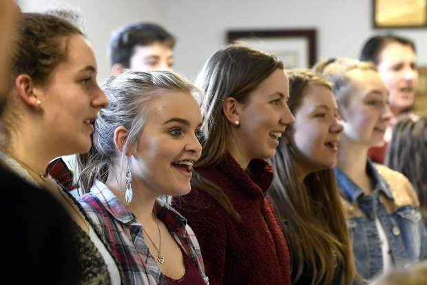 Members of the Glenwood Springs High School are all smiles as they sing for visiting musician Leon WIlliams Tuesday.