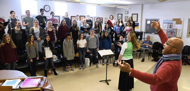 Singer Leon Williams helps Glenwood Springs High School Choir Director Shanti Gruber work with the concert choir during an outreach program Tuesday. Williams was in town to perform as part of the Glenwood Springs Community Concert Associaton's 2018-19 season.