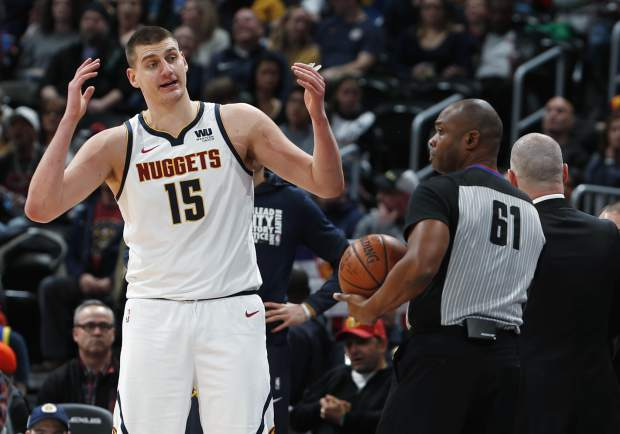 Denver Nuggets center Nikola Jokic, back, argues with referee Courtney Kirkland after he called Jokic for a foul against the Los Angeles Clippers in the second half of an NBA basketball game Sunday, Feb. 24, 2019, in Denver. The Nuggets won 123-96. (AP Photo/David Zalubowski)