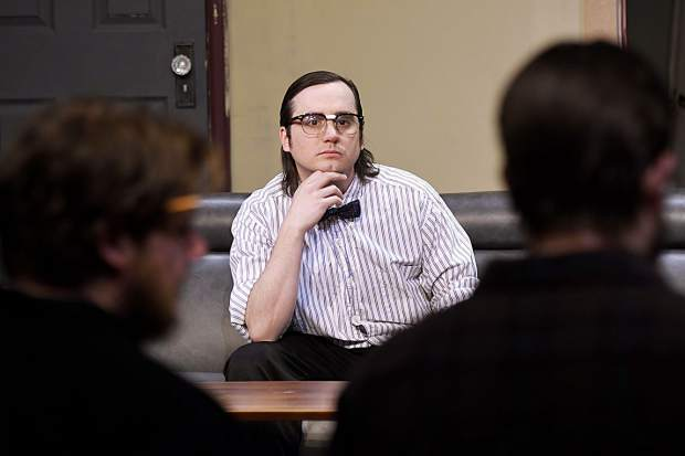 Justin Tinker, who plays Rick Steadman, listens to input as the cast goes through scene walk-throughs earlier this week at CMC's Spring Valley campus.