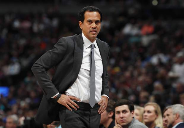 Miami Heat head coach Erik Spoelstra looks on in the first half of an NBA basketball game against the Denver Nuggets, Monday, Feb. 11, 2019, in Denver. (AP Photo/David Zalubowski)