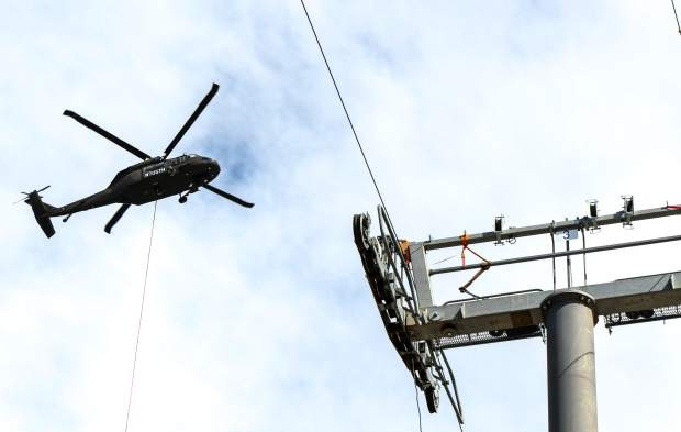 The Glenwood Caverns Adventure Park used a Black Hawk helicopter on Tuesday morning to set the sheave assemblies to run the cables on the new Glenwood Gondola that is under construction on Iron Mountain.