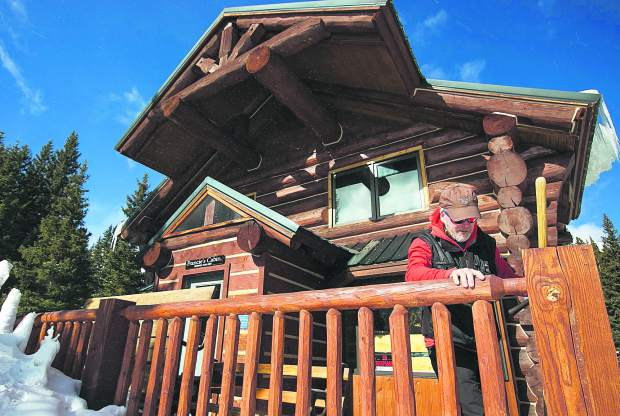 Summit Huts Association hutmaster Scott Toepfer fixes a post at Francie's Cabin on Tuesday, Feb. 5, near Blue River.