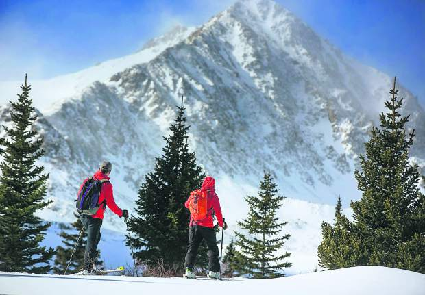 Summit Huts Association hutmasters Steve Huyler, left, and Scott Toepfer hike in the Tenmile Range for routine check-in and maintenance at Francie's Cabin on Tuesday, Feb. 5, near Blue River.