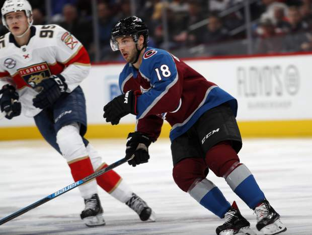 Colorado Avalanche center Derick Brassard, right, who was just acquired in a trade with the Florida Panthers, pursues the puck with former teammate Panthers center Henrik Borgstrom in the second period of an NHL hockey game Monday, Feb. 25, 2019, in Denver. (AP Photo/David Zalubowski)