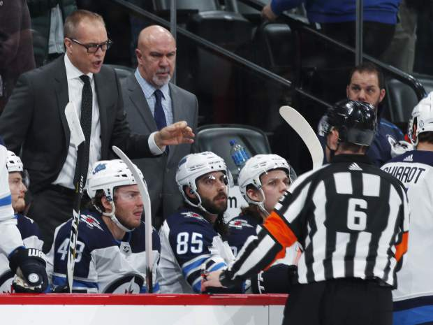 Winnipeg Jets head coach Paul Maurice, left, argues with referee Francis Charron about a goal scored by Colorado Avalanche center Carl Soderberg in the second period of an NHL hockey game Wednesday, Feb. 20, 2019, in Denver. (AP Photo/David Zalubowski)