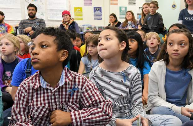 Students and adults listen to a presentation by Jenni Fautsko about Rare Disease Day at Sopris Elementary School on Thursday morning.