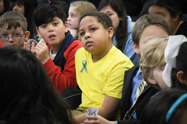 Sopris Elementary School third-grader Diamond White wears his blue ribbon during a presentation about Rare Disease Day with his third grade class on Thursday morning.