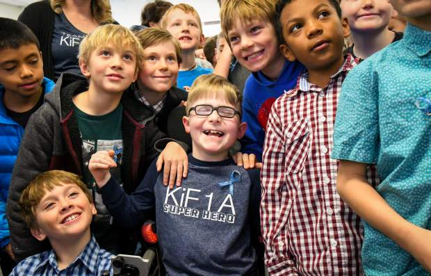 Sopris Elementary School third-grader Turner Fautsko is embraced by his friends and fellow classmates after a presentation calling attention to Rare Disease Day. Fautsko was diagnosed with a rare genetic condition, KiF1A Associated Neurological Disorder. His mother, Jenni, gave the presentation to third-grade students at the school on Thursday morning. Rare diseases affect more than 350 million people worldwide, and 50 percent of those are children, according to globalgenes.org.
