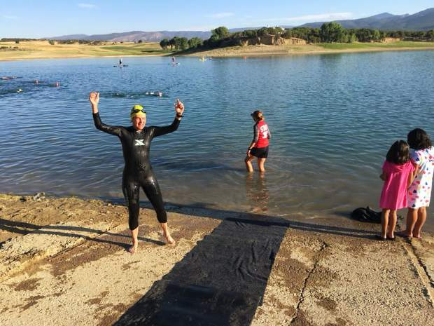 Nancy Reinisch completes a swim training at Harvey Gap with the Roaring Fork Women's Triathlon team one week before the her 100th trathlon last summer.