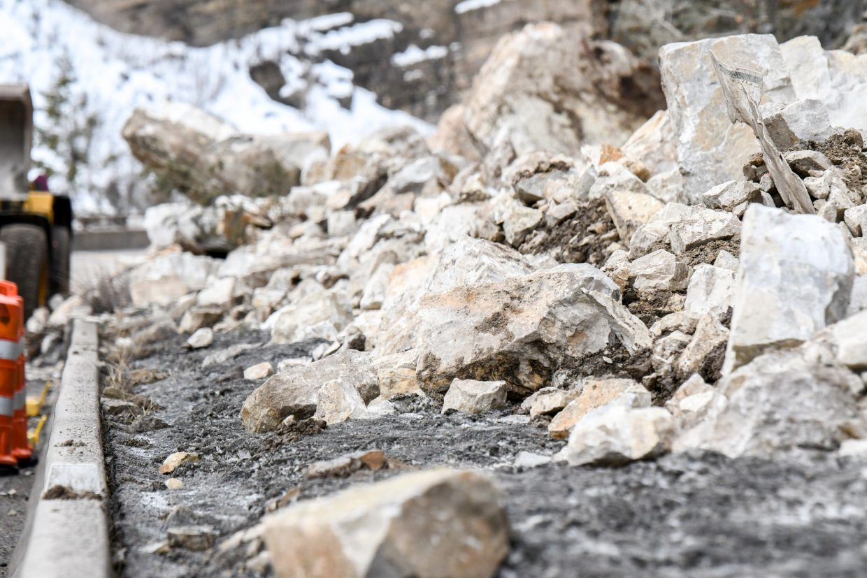 Large boulders and rocks are piled on the shoulder of I-70 near Grizzly Creek in Glenwood Canyon after an early morning rockslide closed the interstate through Glenwood Canyon on Tuesday.