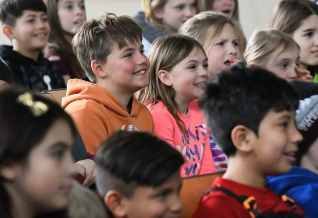 Two Rivers Community School students laugh and listen along during the Colorado Shakespeare Festival performance at the school on Tuesday afternoon.