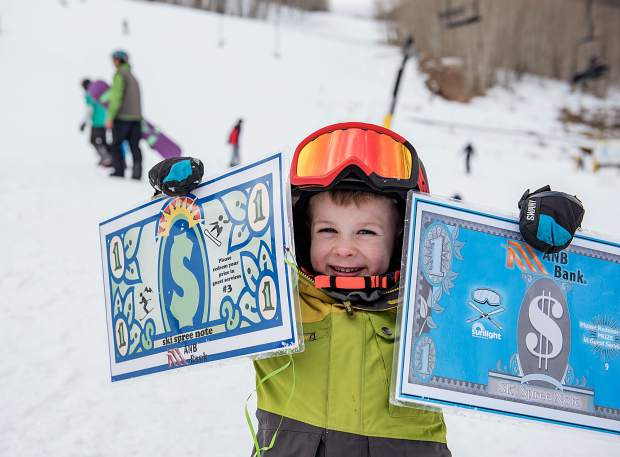 Elijah Mattson of New Castle shows off his haul from a past Mountain Treasure Hunt.