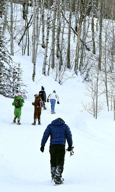 Competitors make the turn to climb up Babbish Gulch Sunday during the Sunlight Mountain Snowshoe Shuffle.