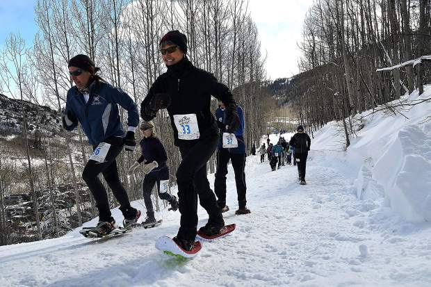 Racers make their way up toward Babbish Gulch in the Sunlight Mountain Snowshoe Shuffle on Sunday morning.