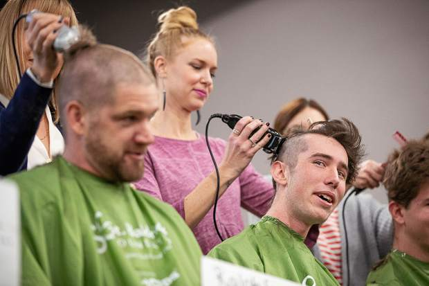 Bear Matthews shaves his head at Basalt High School to honor Anna Cunningham, a student battling Ewing sarcoma on Wednesday morning.