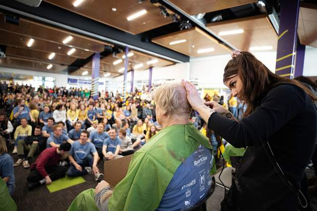 Red Cunningham gets his head shaved at Basalt High School on Wednesday morning to honor his daughter, Anna, that is battling Ewing sarcoma.