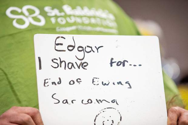 A sign from one of the shavees at Basalt High School for a St. Baldrick's Foundation fundraiser for cancer on Wednesday morning.