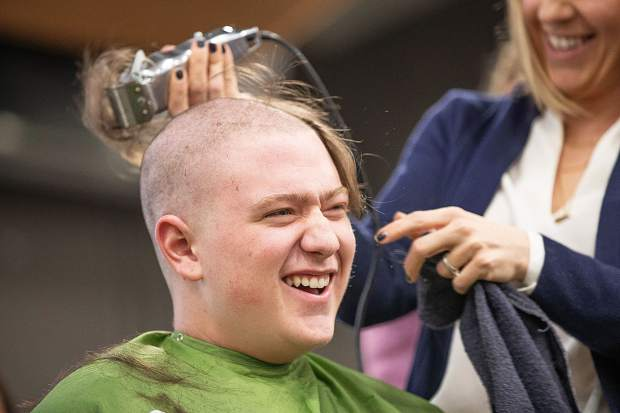 BHS sophomore Koa Fond shaves his head at Basalt High School to honor Anna Cunningham, a student battling Ewing sarcoma on Wednesday morning.
