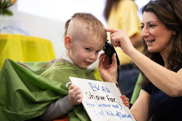 Evan Adler, 5, shaves his head at Basalt High School to honor Anna Cunningham, a student battling Ewing sarcoma on Wednesday morning.