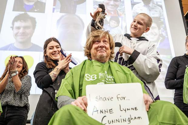 Red Cunningham gets his head shaved by his son Cooper at Basalt High School on Wednesday morning to honor his daughter, Anna, who is battling Ewing sarcoma.