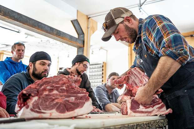 Aspen Center for Environmental Studies Rock Bottom Ranch Director Jason Smith butchers a pig Tuesday afternoon to educate Roaring Fork Valley chefs and employees at grocers how the whole animal can be used.