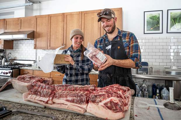 Rock Bottom Ranch Director Jason Smith demonstrates how to butcher a pig Tuesday afternoon and how less coveted cuts of meat can be used.