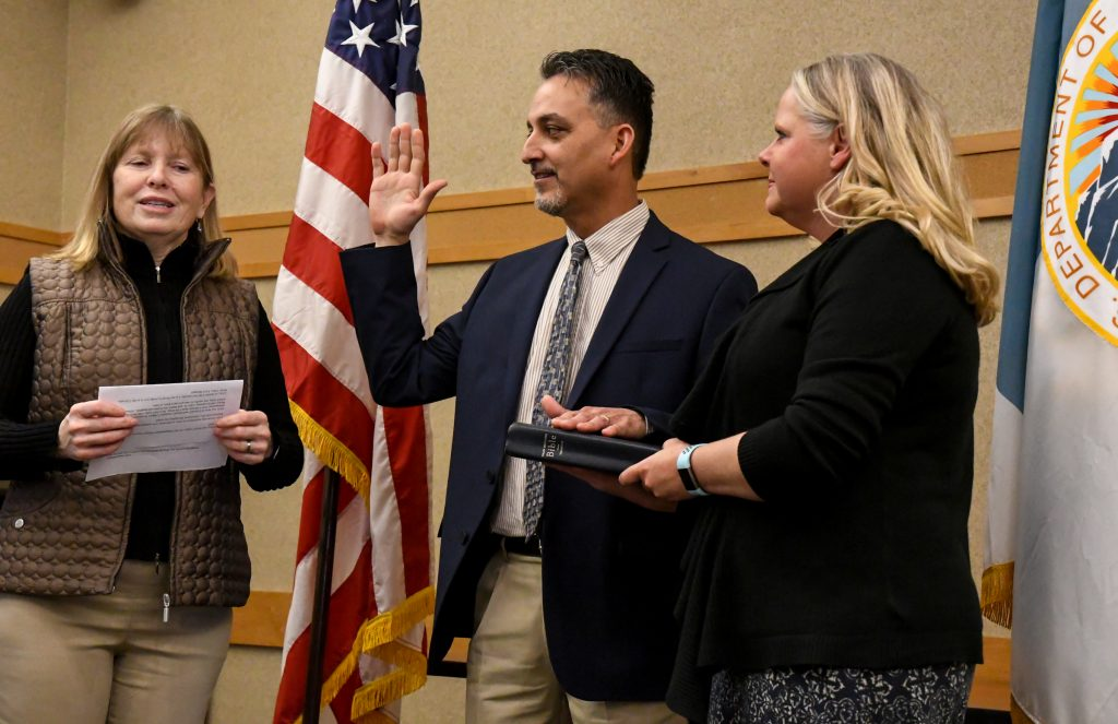New BLM Colorado River Valley Field Office Manager Larry Sandoval is sworn in by BLM Colorado State Director Jamie Connell alongside his wife at the swearing-in ceremony in Silt on Monday afternoon.