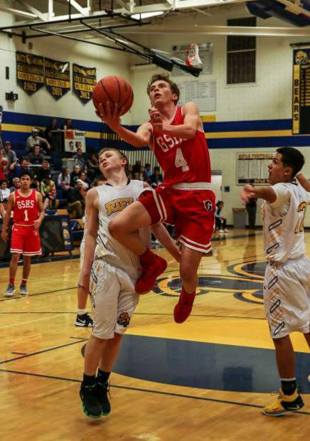 Glenwood junior Mitchell Burt skies for a layup on the road at Rifle High School as junior Trey Lujan defends.