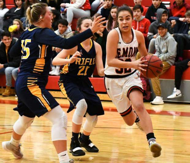 Glenwood senior guard Ximena Gutierrez drives past Rifle's Masi Smith and freshman Jamie Caron during a rivalry game last season inside Chavez-Spencer Gymnasium in Glenwood Springs.