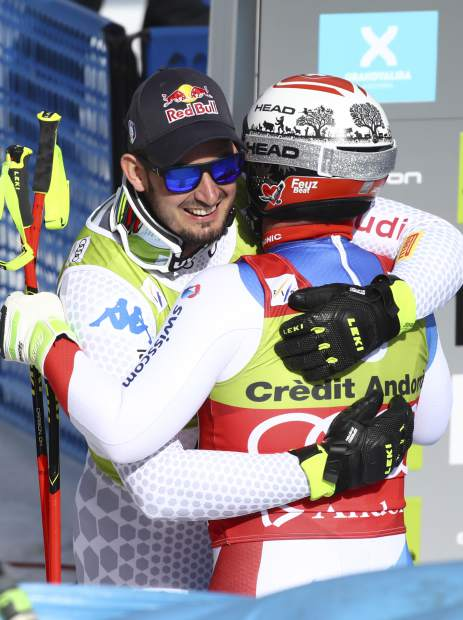 Italy's Dominik Paris embraces Switzerland's Beat Feuz after competing in the men's downhill race at the alpine ski World Cup finals, in Soldeu, Andorra on Wednesday.