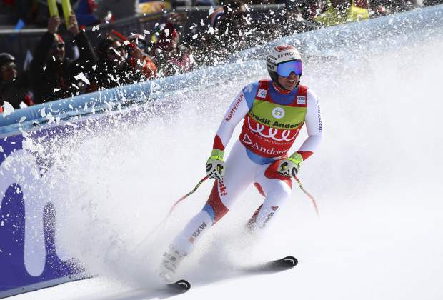 Switzerland's Beat Feuz reacts after competing in the men's downhill race at the alpine ski World Cup finals, in Soldeu, Andorra, Wednesday, March 13, 2019. (AP Photo/Alessandro Trovati)