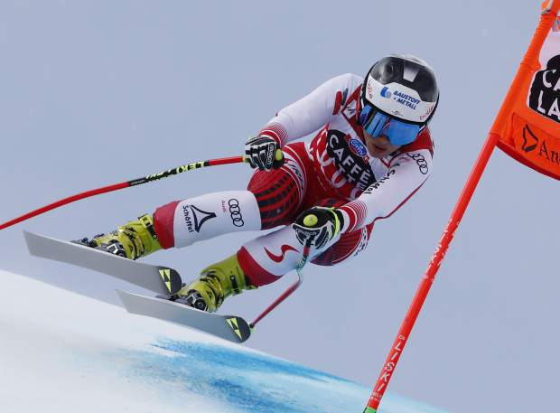 Austria's Nicole Schmidhofer competes during the women's downhill race at the alpine ski World Cup finals, in Soldeu, Andorra, Wednesday, March 13, 2019. (AP Photo/Gabriele Facciotti)