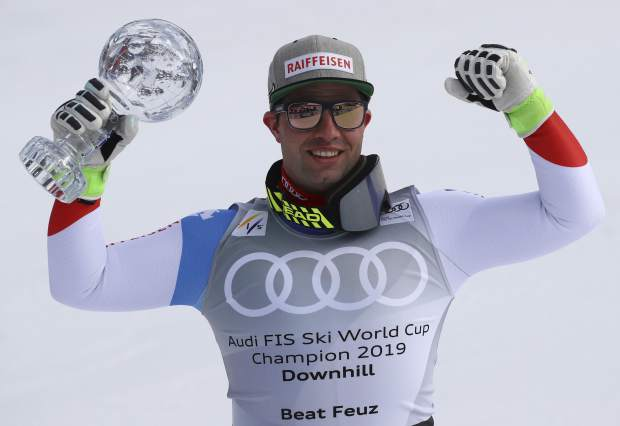 Switzerland's Beat Feuz celebrates with the men's World Cup downhill discipline trophy at the alpine ski World Cup finals in Soldeu, Andorra on Wednesday.