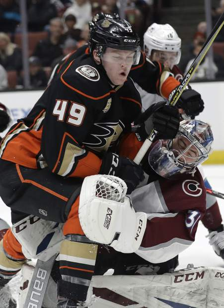 Anaheim Ducks' Max Jones (49) collides with Colorado Avalanche goaltender Philipp Grubauer, right, during the second period of an NHL hockey game Sunday, March 3, 2019, in Anaheim, Calif. (AP Photo/Marcio Jose Sanchez)