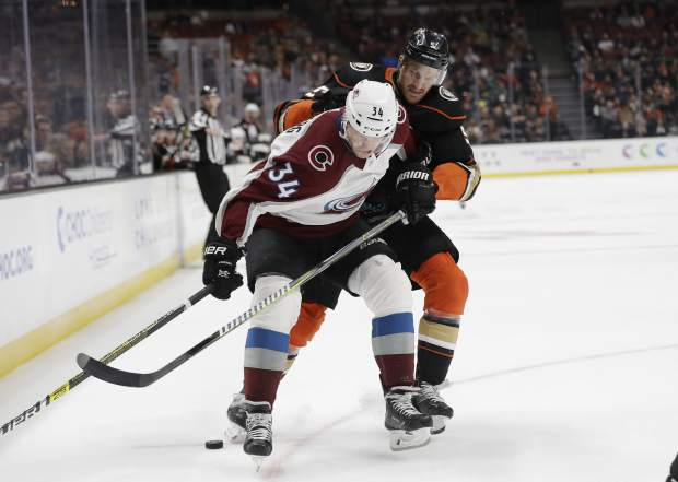 Colorado Avalanche's Carl Soderberg, left, is defended by Anaheim Ducks' Korbinian Holzer during the first period of an NHL hockey game Sunday, March 3, 2019, in Anaheim, Calif. (AP Photo/Marcio Jose Sanchez)